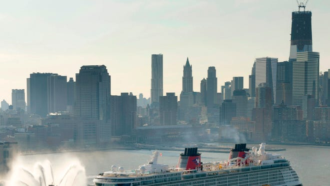 The Disney Fantasy, one of four in the Disney Cruise Line fleet, sails past the Manhattan skyline in 2012.  The cruise line ranked highest in Friends of the Earth's recent report card rating lines on three key environmental factors.