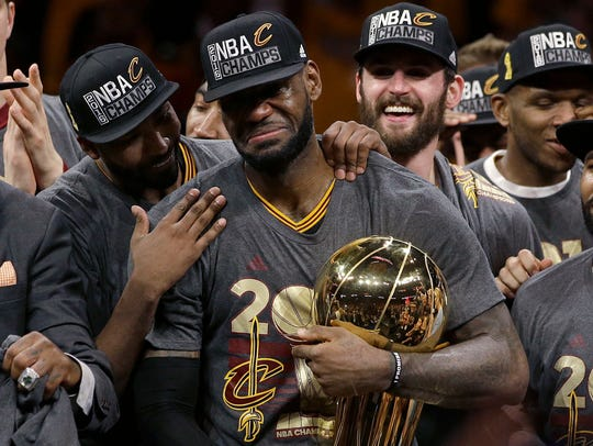 LeBron James, center, brought an NBA title to Cleveland.