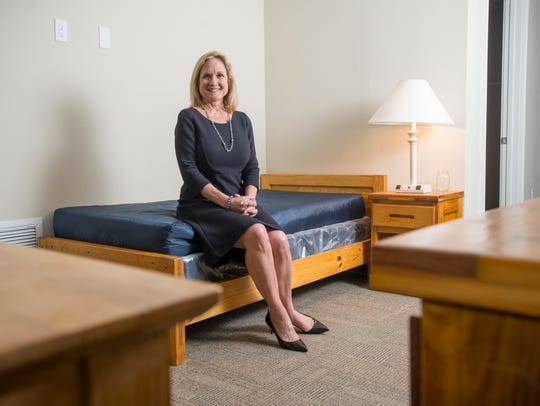 Connie Bookman, founder of Pathways for Change, sits