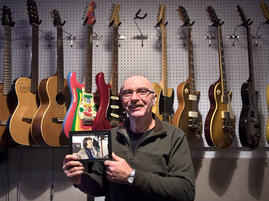 "Wes Henley, of Jackson, poses for a portrait with a photograph of music legend Carl Perkins on Wednesday, Jan. 17, 2017, at Highland House Productions in Jackson. Henley played guitar in Perkins' band and owns a photograph of his last ever recording session in October 1997. ""[Perkins] was my hero growing up,"" Henley said. ""He's the reason I started playing guitar in the first place. Personally, I remember him as my fishing buddy. Much like a second father to me. We were very close."""