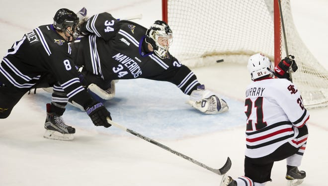 St. Cloud State's Jimmy Murray scores a third-period goal that puts the Huskies up 5-4 over Minnesota State-Mankato on Saturday at Xcel Energy Center in St. Paul.