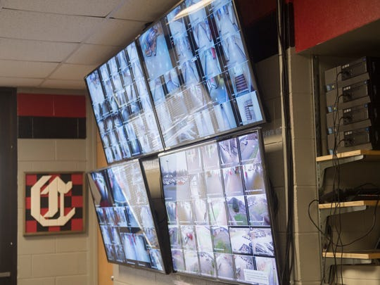 Security cameras on screen in Central High principal Michael Reynolds' office.