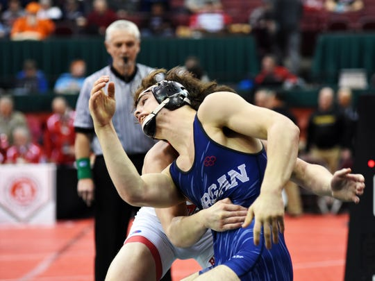 Morgan's Wesley Pauley tries to escape the grasp of Bellevue's Justin Mayes during their seventh place match at 160 pounds during the Division II state tournament on Saturday at Value City Arena. Pauley lost the match, 4-3.