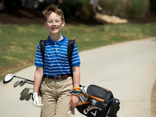 Charlie Frost, 12, at the Food City KidÕs Clinic at Fairways and Greens on Sunday, May 6, 2018.