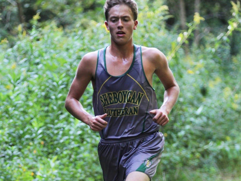Sheboygan Lutheran cross country runner Lucas Parmley is spotlighted.