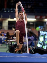 Louis Logsdail competes in the pole vault during the