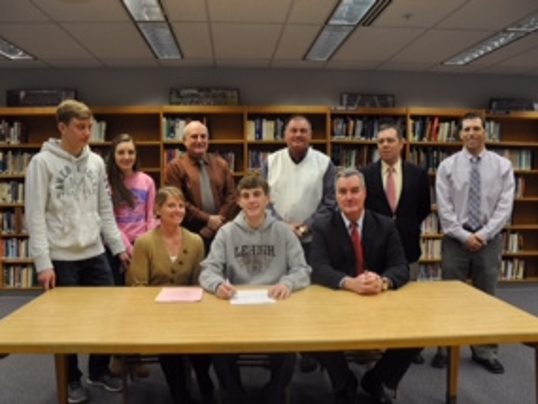 Dallastown senior Patrick Reilly signs his letter of intent to run at Lehigh -- Submitted.