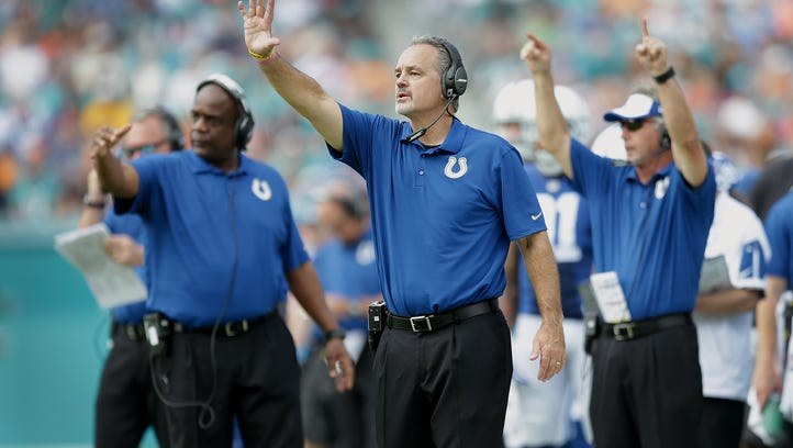 Indianapolis Colts head coach Chuck Pagano and Joe Reitz (76) begin to celebrate their win late in the fourth quarter of their game. The Indianapolis Colts hang on to defeat the Miami Dolphins  18-12 Sunday, December 27, 2015, afternoon at Sun Life Stadium in Miami Gardens, FL.