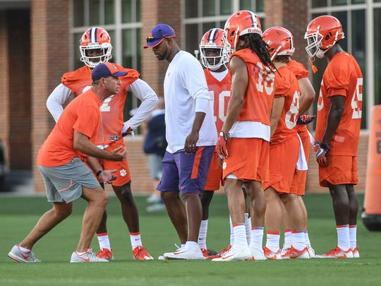 Clemson head coach Dabo Swinney and receiver coach Xavier Dye with receivers during the first day of practice at the Clemson Indoor Football facility at Clemson on Friday, August 3, 2018.