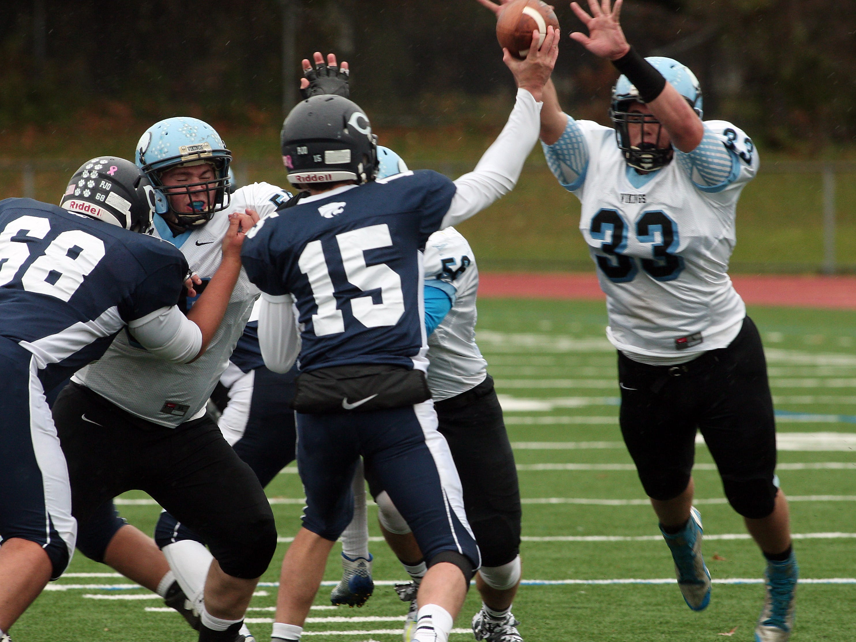 Parsippany Hills' Jared Salgado bears down on Chatham quarterback Alex Sands, knocking down the pass during a game earlier this season.