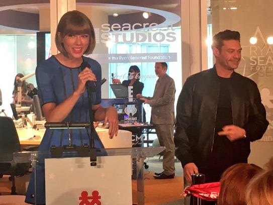 Taylor Swift and Ryan Seacrest at the opening of Seacrest