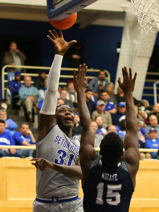Seton Hall's Angel Delgado (31) attempts a shot as St. Peter's Mamadou Ndiaye (15) defends during the second half of an NCAA college basketball game in South Orange, N.J., Tuesday, Dec. 12, 2017. Seton Hall defeated St. Peter's 84-61. (AP Photo/Rich Schultz)