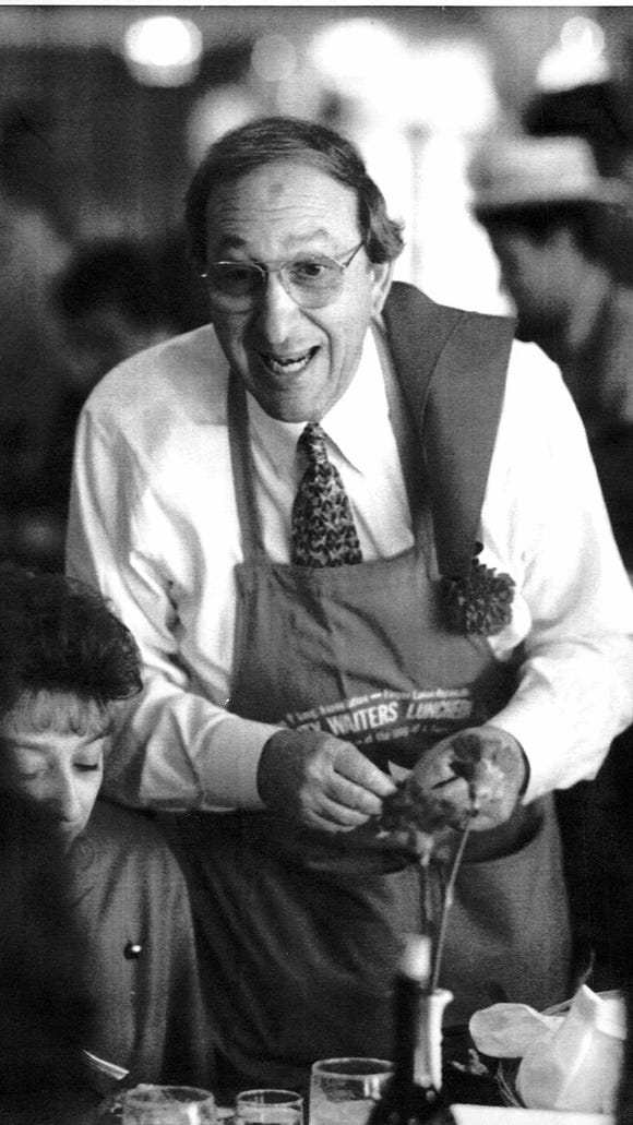Monroe County Sheriff Andrew Meloni hustles for donations at the American Lung Association's 11th annual Celebrity Waiters' Luncheon in 1993.