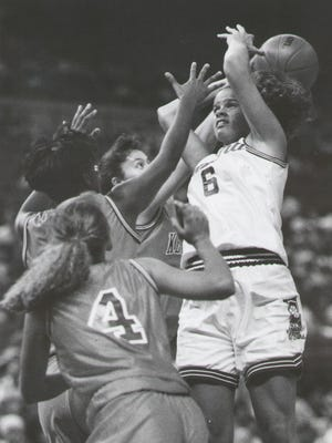 Benton Central graduate Faith Cyr, right, tries to keep control of the ball during the 1992  Indiana-Kentucky girls All-Star game.