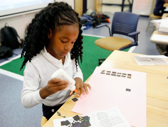 3rd-grader Saniyah Trotter works on an art project