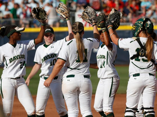 Baylor takes the field in the second inning of an NCAA Women's College World Series softball tournament game against Kentucky in Oklahoma City, Saturday, May 31, 2014. (AP Photo/Garett Fisbeck)