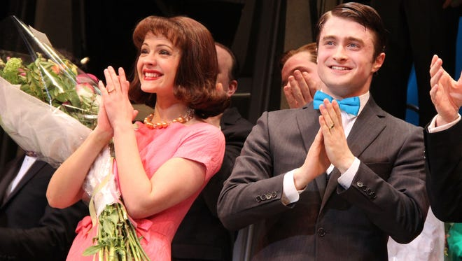 """Rose Hemingway and Daniel Radcliffe take their curtain call on opening night of """"How To Succeed In Business Without Really Trying"""" on Broadway in 2011."""