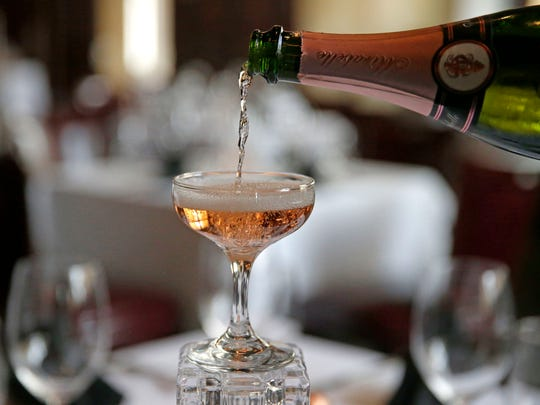 Every celebration, including Thanksgiving, should begin with bubbly, says Jason Wedner, general manager of Rare Steakhouse, here pouring a Schramsberg Mirabelle brut rosé sparkling wine.