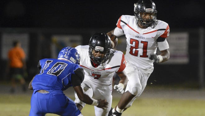 BJ Daniels of Palm Bay (21) gets a block and heads into the open field during Friday's game against Heritage.