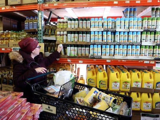 Eileen Grossman shops inside the Passover tent at Evergreen Kosher Market in Monsey March 22, 2018.