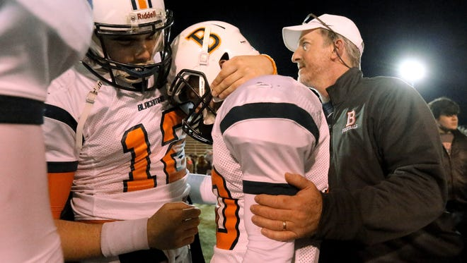 Blackman's quarterback and senior Miller Armstrong (12), left, comforts senior teammate Blake Taylor (10), center following the loss to Maryville in the quarterfinal playoff game on Friday, Nov. 20, 2015. Far right assistant Blackman football coach John McCreary comforts Taylor also. Final score 42-7.