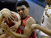 Chaminade's Reginald Crawford Jr., center, fights for a rebound with Kickapoo's Cameron Davis, left, as Kickapoo's Niekie Thomas-Fontleroy watches during the first half of the Missouri Class 5 boys high school championship basketball game Saturday, March 19, 2016, in Columbia, Mo. (AP Photo/Jeff Roberson)