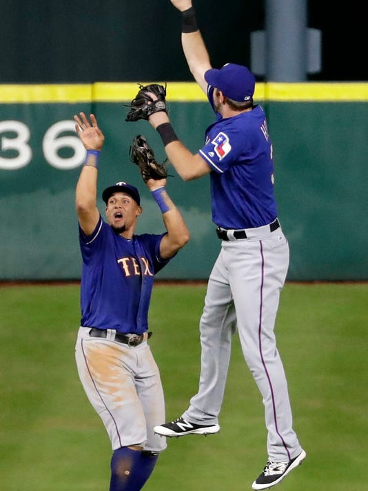 Texas Rangers' Carlos Gomez, left, and Jared Hoying celebrate after the Rangers defeated the Houston Astros 3-2 in a baseball game Tuesday, Sept. 13, 2016, in Houston. (AP Photo/David J. Phillip)