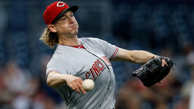 Cincinnati Reds starting pitcher Bronson Arroyo throws to first to get San Diego Padres starting pitcher Luis Perdomo at first on a sacrifice bunt during the second inning of a baseball game in San Diego, Monday, June 12, 2017. (AP Photo/Alex Gallardo)