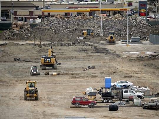 Heavy equipment scurries across the Titletown District construction site May 4,  2016.