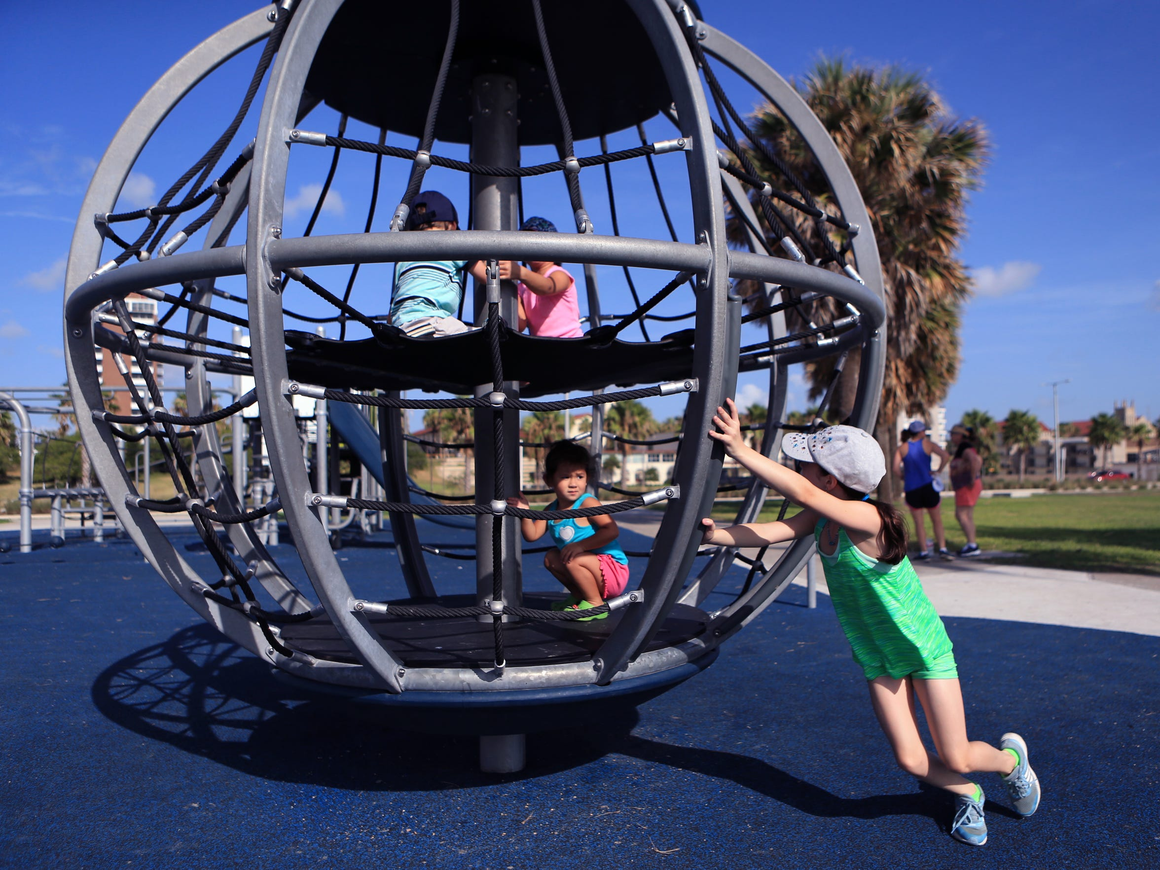 Genevieve Sengler, 10, pushes a play structure for her cousins and sibling in a new play area at the Water's Edge on the Bayfront on Tuesday, July 18, 2017. While some areas, such as the bathrooms, are still under construction, several areas are open for use.