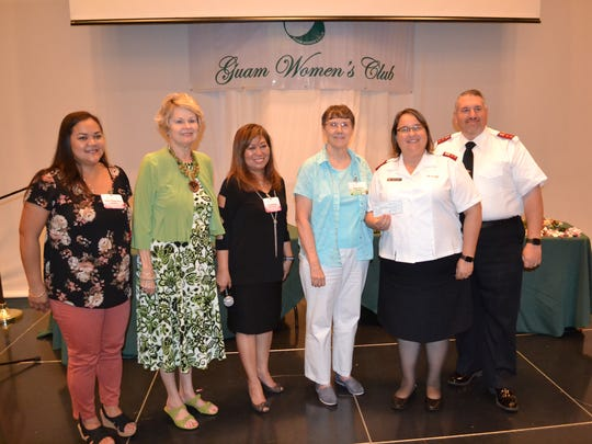 Guam Women's Club presented a check in the amount of $11,000 to the Salvation Army at their general membership meeting held on May 25, 2018 at the Sheraton Laguna Guam Resort. Proceeds raised from GWC/Salvation Army's Rock Aid XI held at the Hard Rock Café on April 21, 2018. Pictured from left: Delisa Kloppenburg, GWC Member; Donna Kloppenburg, GWC Past President; Leo Jordanou, GWC President; Nancy Weare, GWC Member; Captain Kim Stambaugh, Salvation Army and Captain Tom Stambaugh, Salvation Army.