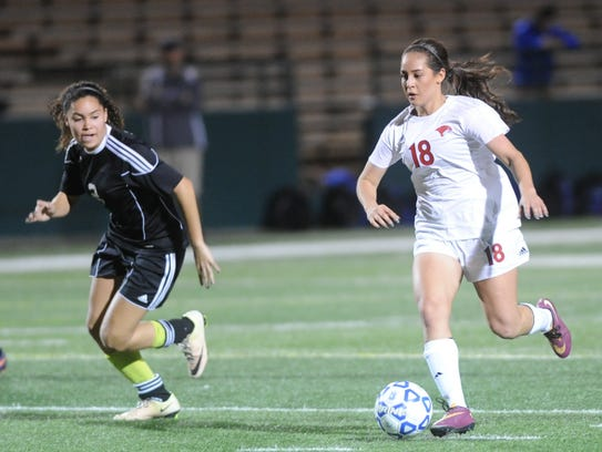 Cooper's Judith Macias (18) goes on the attack as Wichita
