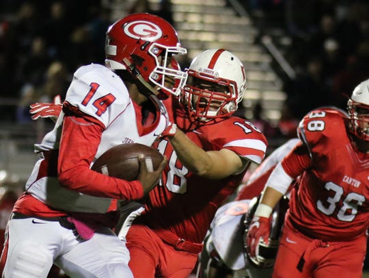 Canton's Reid McDonnell (No. 18) closes in on Westland