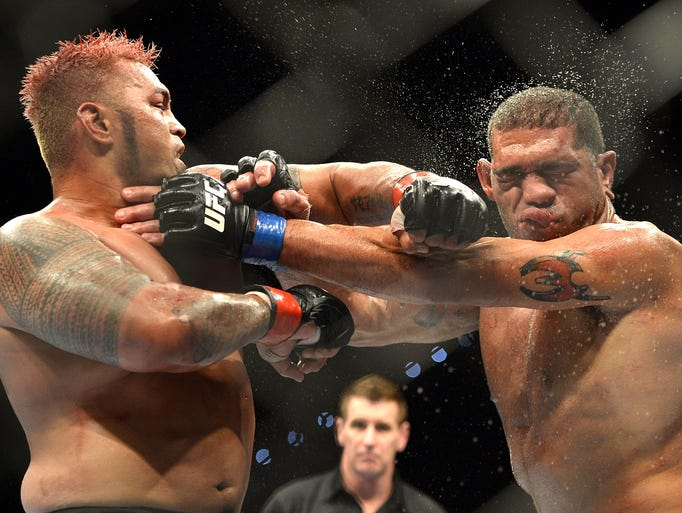 "Mark Hunt connects with a punch on Antonio ""Big Foot"" Silva during their fight at the Brisbane Entertainment Centre."