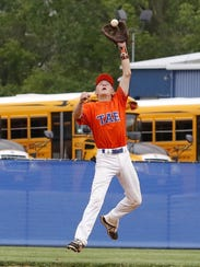 Edison shortstop Logan Peters makes a leaping catch