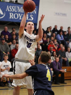 Pittsville's Jacob Schulz shoots over Marshfield Columbus' Tyler Fuerlinger in the game against Columbus Columbus during the Cranberry Classic held in Wisconsin Rapids Friday night.