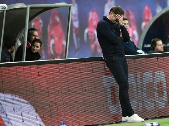 Leipzig's head coach Ralph Hasenhuettl gestures during the German first division Bundesliga soccer match between RB Leipzig and Bayer Leverkusen in Leipzig, Germany, Monday, April 9, 2018. (AP Photo/Jens Meyer)