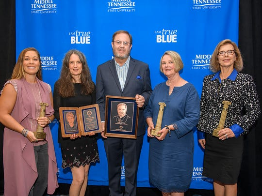 The ceremony for the 2017 Distinguished Alumni and True Blue Citations of Distinction Awards was held Friday, Oct. 6, in the Ingram Building. Pictured, from left, are Whitney Dix (Class of 99), recipient of the David Pullum Award for Service to the University; -Mrs. McMahon, mother of Tierra McMahon (class of 2003), received the Young Alumni Achievement Award on behalf of her daughter; -Eddie Gossage (Class of 1982), recipient of the Distinguished Alumni Award; Susan Young, widow of Doug Young (C;ass of 1971), received the Service to the Community Award on behalf of her deceased husband; Paula Thomas (Classes of 1978 and 1983), recipient of the True Blue Citations of Distinction Achievement in Education.