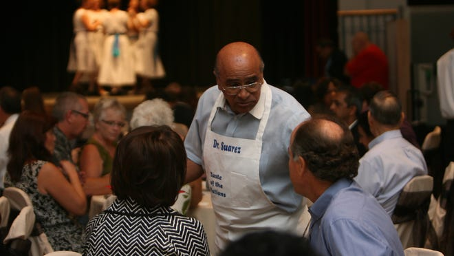 Nations Association Charities Executive Director, Dr. Israel Suarez, center, chats with attendees in 2011.