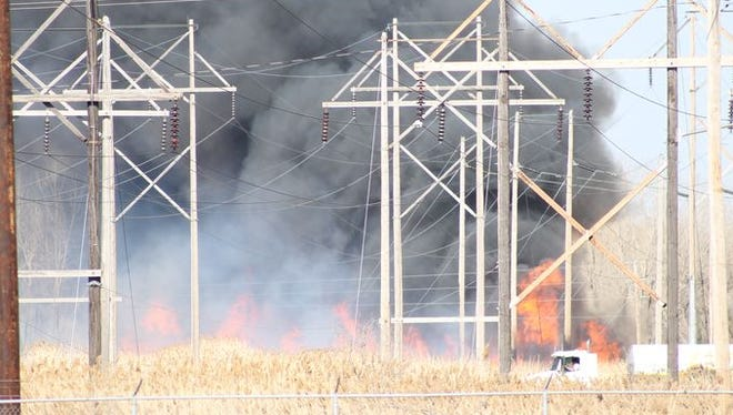 A grass fire at the Ken Euers Nature Area on Green Bay's northwest side on April 12.