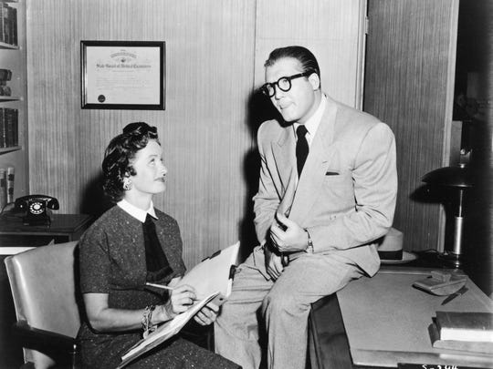 """Actress Noel Neill, best known for her role as Lois Lane in """"The Adventures of Superman,"""" has died. She is pictured from a scene of the television show with American actor George Reeves (1914 - 1959), who played Clark Kent/Superman."""