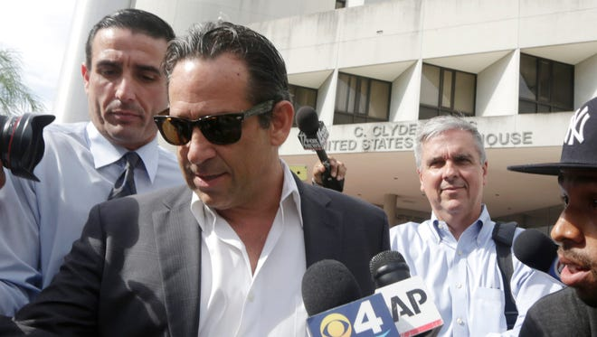 Tony  Bosch leaves the federal courthouse in Miami after paying bond.