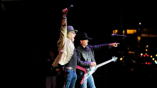 Big Kenny Alphin and John Rich of Big & Rich perform on Broadway at the Battle of the Bands for the Franklin American Mortgage Music City Bowl on Tuesday, Dec. 29, 2015, in Nashville.