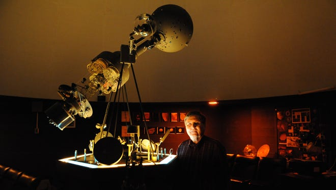Ron Derewicki, retired science teacher for Coshocton City Schools, poses in the planetarium at Central Elementary School.