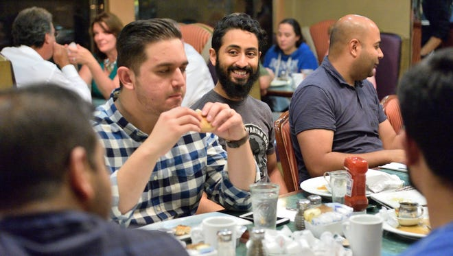 Ilyas K. Sultan of Bergenfield, center, meets with friends at the Chit Chat diner in Hackensack last Saturday to have a suhoor during the month of Ramadan.