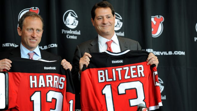 New Devils owners Joshua Harris and David Blitzer during a press conference at the Prudential Center.