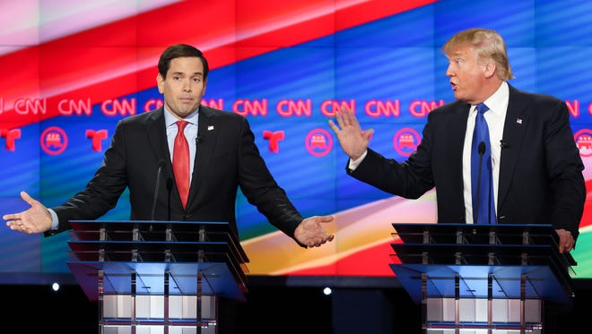 Republican presidential candidates, Sen. Marco Rubio, R-Fla, left, and businessman Donald Trump argue during the GOP debate Thursday in Houston.