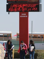 East Montana Middle School students head home after school Wednesday.