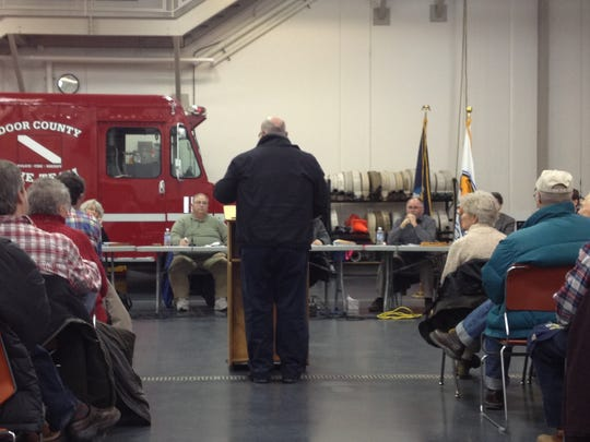 Door County Visitor Bureau President Jack Moneypenny addresses the Sturgeon Bay Plan Commission on Wednesday night. The session was moved to the Fire Department truck bay because of the size of the expected crowd.