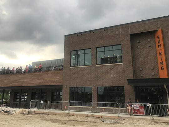 Construction continues on a public park in front of Sun King Spirits in Carmel. The distillery/food hall, with a rooftop patio, opened July 2, 2018.